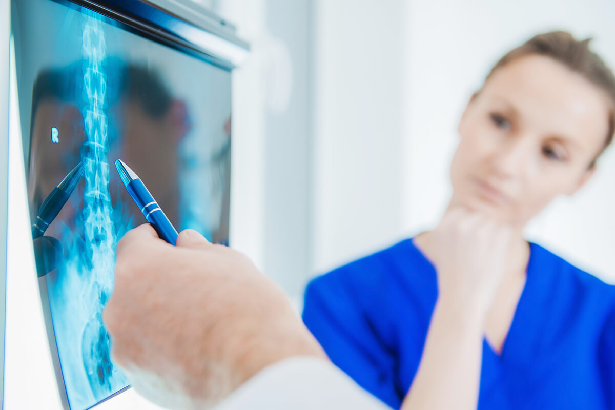 chiropractor examining x-rays